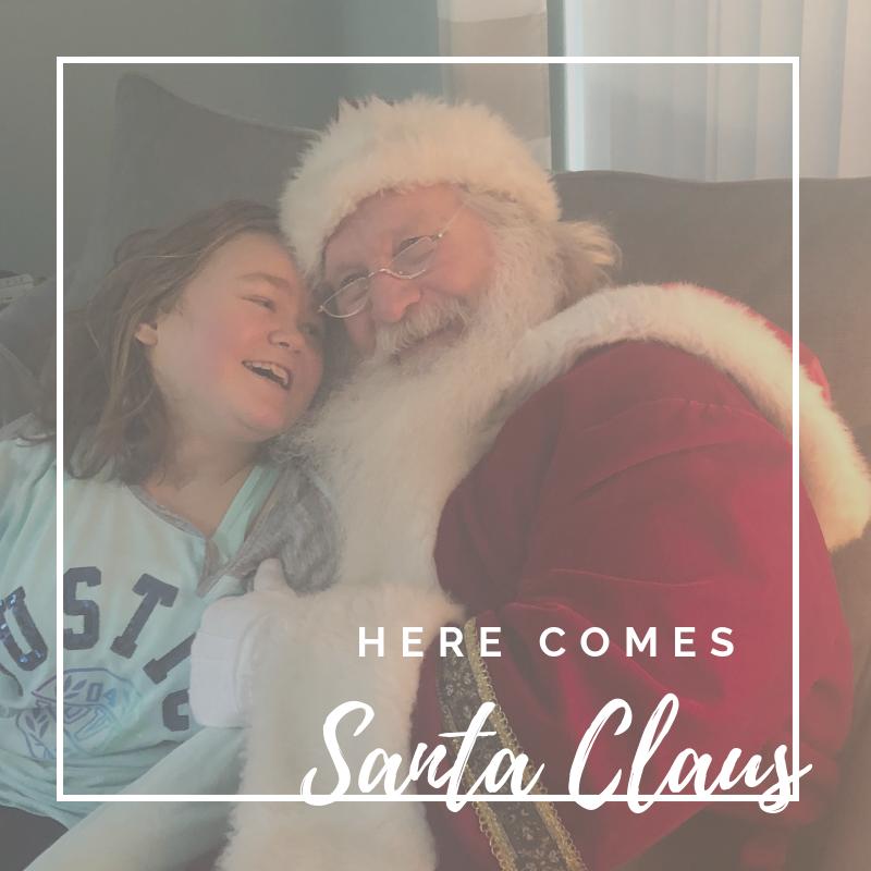 child smiling at santa claus